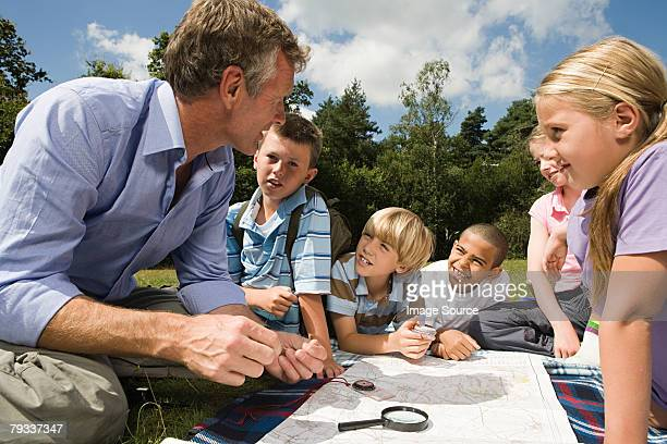Teacher and pupils with map