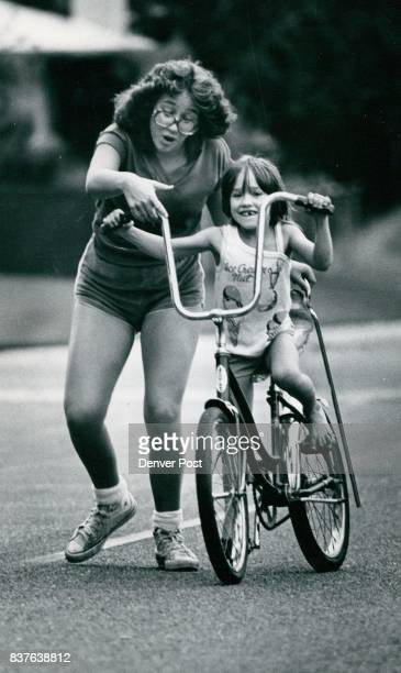 Teacher And Student For the shaky experience of learning to ride a bicycle 6yearold Theresa von Schutes 3992h W Eastman Ave had the shoulder of her...