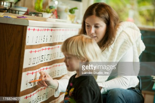 Teacher and student with a number line : Stock Photo