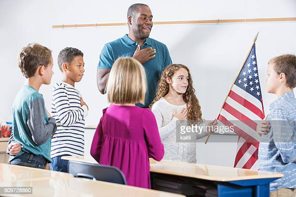 Teacher and students, American pledge of allegiance