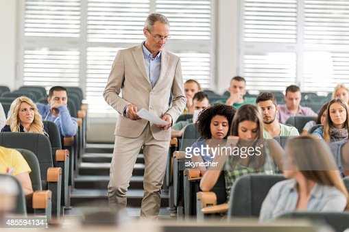 Teacher and students during exam in the classroom.