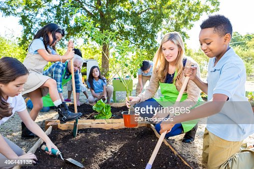 Teacher and students gardening during farm field trip