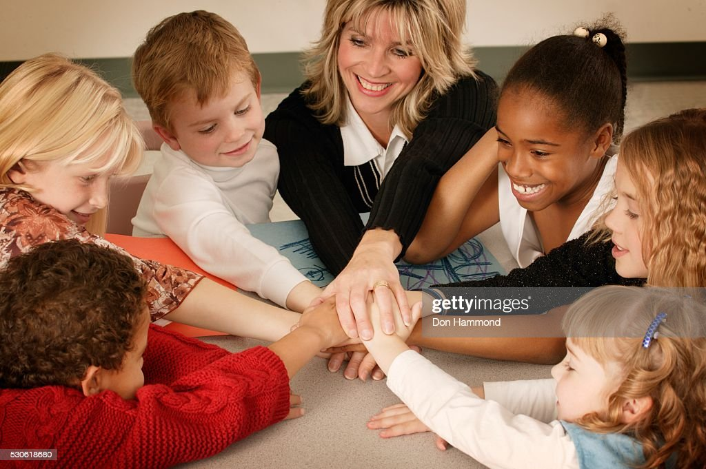 Image result for teacher and students holding hands