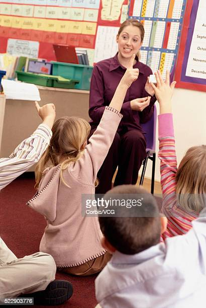 Teacher and students in a class setting