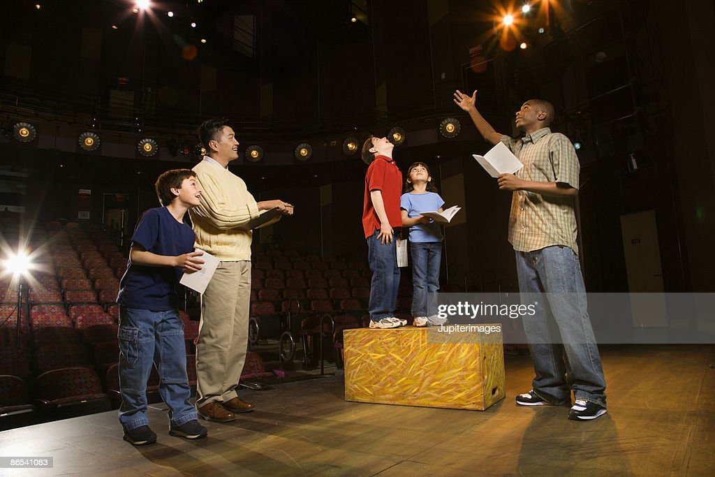 Teacher and students practicing a play