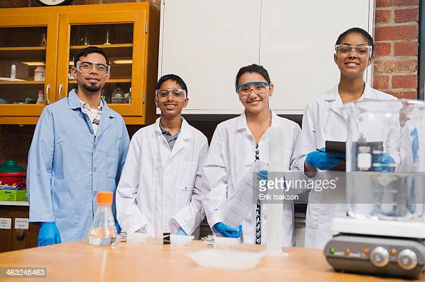 Teacher and students smiling in science lab