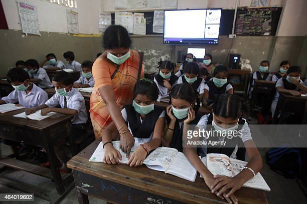 Teacher and the students of a class have taken to wearing masks to avoid contracting swine flu in Mumbai India on 20 February 2015 Forty more deaths...