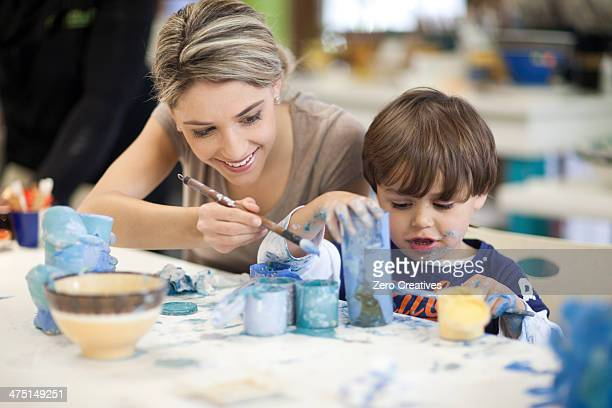 Teacher and toddler playing in art class