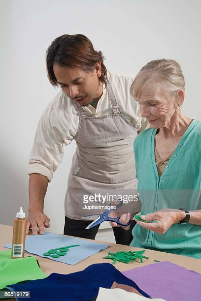 Teacher and woman doing arts and crafts