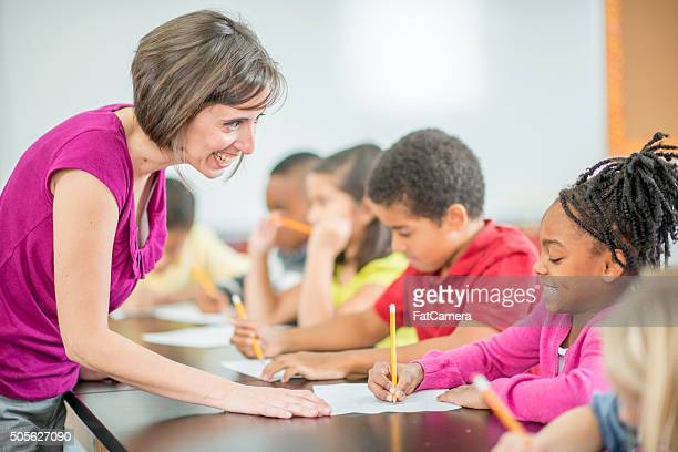 Teacher Answering a Child's Question