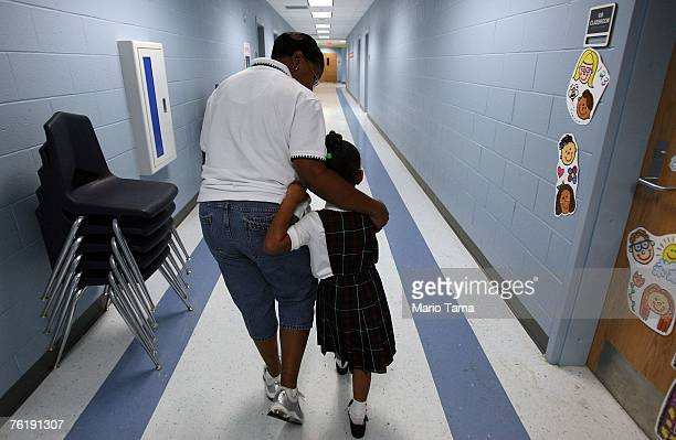 Teacher Anya Anderson comforts kindergartner Eriana Hoffman on her first day of school at Dr Martin Luther King Jr Charter School for Science and...