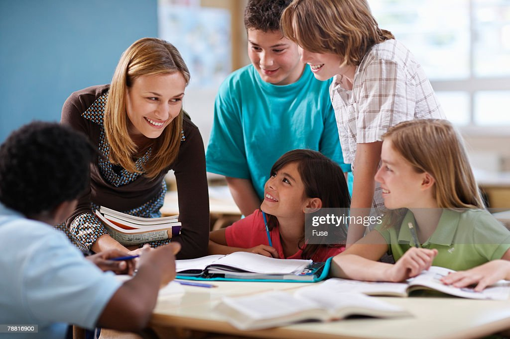 Teacher Assisting Group of Students