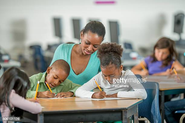 Teacher Assisting Students with Homework