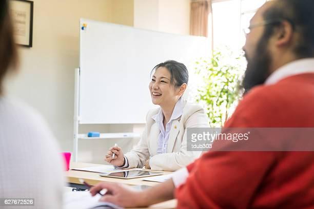 Teacher at training seminar or continuing education classroom for adults