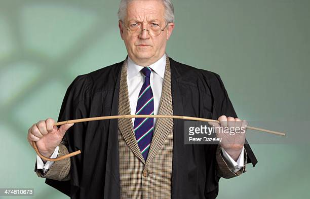 Teacher, cane and gown