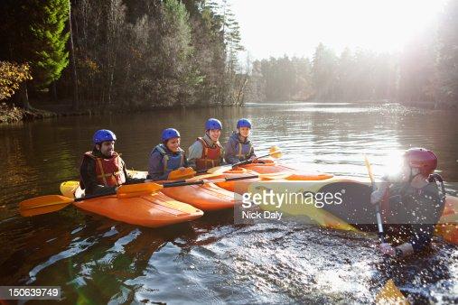 Teacher capsizing kayak in still lake