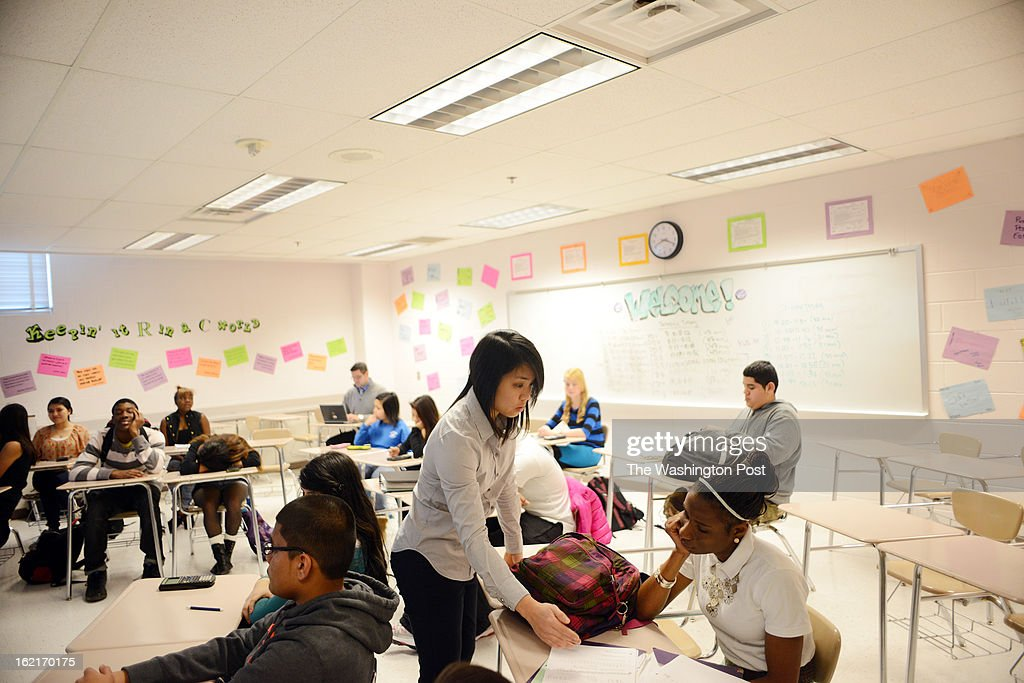 Teacher Carmen Tong, standing in the center, teaches math at Rockville High School while consulting teacher Patrick Bilock, to the left in the back, observes her. Tong is a new math teacher at MCPS who receives teaching guidance from her consulting teacher..