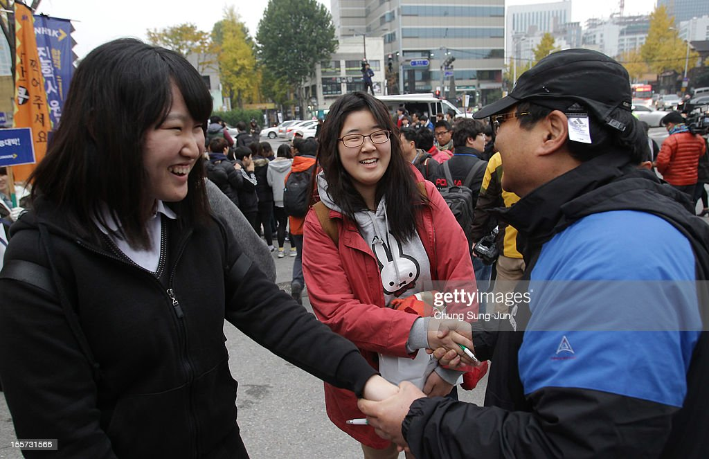 A teacher cheers on his students taking the College Scholastic Ability Test at a school on November 8, 2012 in Seoul, South Korea. More than 660,000 high school seniors and graduates sit for the examinations at 1,100 test centers across the country, where academic records are all important. Success in the exam, one of the most rigourous standardized tests in the world, enables students to study at Korea's top universities.