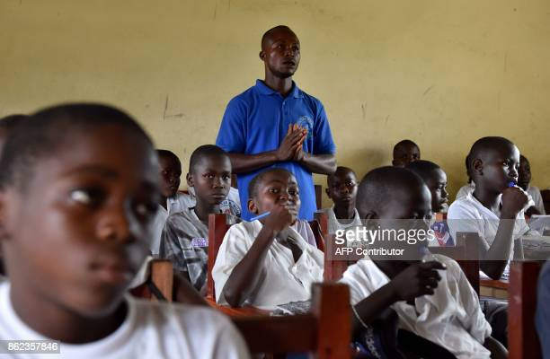 A teacher delivers a lesson to his students in the classroom at the Cecelia Dunbar Public school in the city of Freeman Reserve in the Todee District...