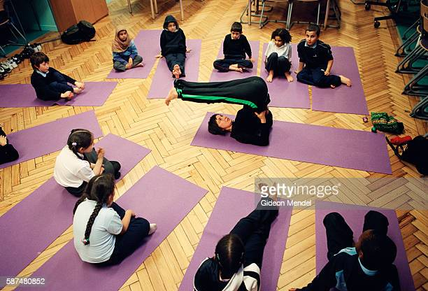 A teacher demonstrated a pose during a yoga class for Year 3 pupils at Millfields Community School This is a large innercity primary school with 604...