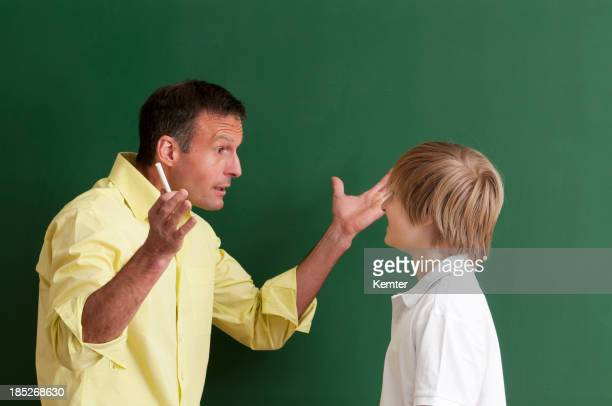teacher discussing with student