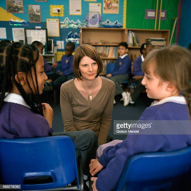 A teacher engages with pupils during a lesson about storytelling at Kingsmead Primary School The school primarily serves children who live on the...