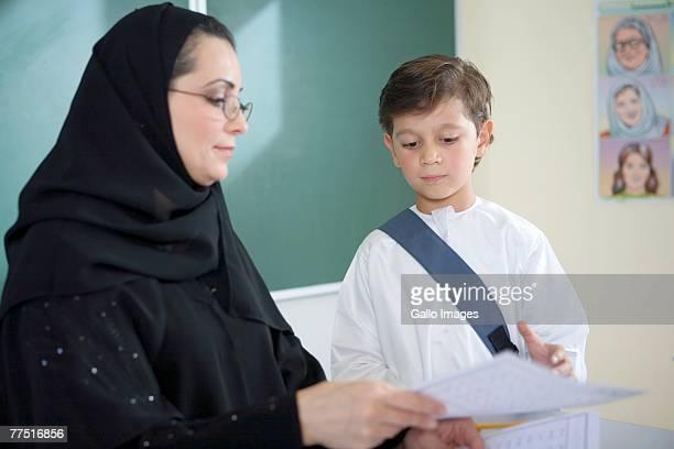 Teacher Explaining Homework to a Student. Dubai, United Arab Emirates