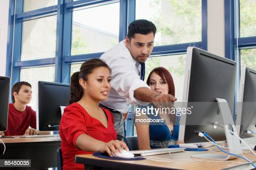Teacher Explaining Something to Students : Stock Photo