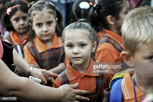 A teacher forms children in rows during the first day of school on September 15 2014 at a primary school at Bayrampasa district in IstanbulMore than...