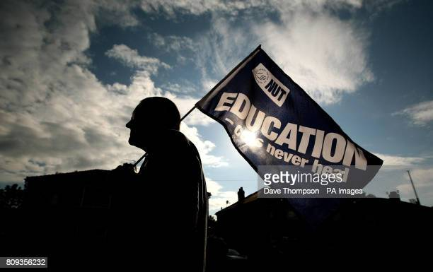 A teacher forms part of a picket line outside Stretford High School Stretford Manchester