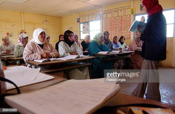 A teacher gives literacy lessons April 16 2004 in Bni Meskine central Morocco about an hour inland by car from Casablanca Inhabitants of Bni Meskine...