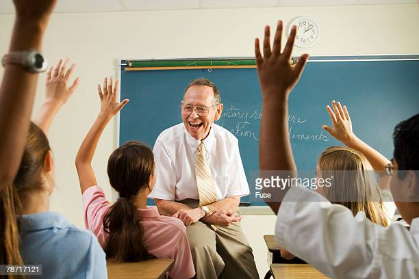 Teacher Happy with Eager Class