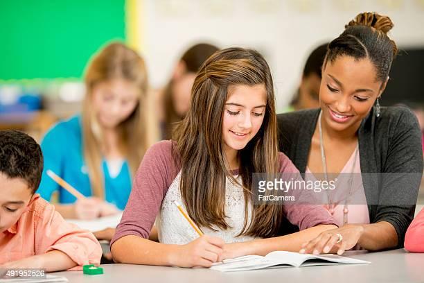Teacher Helping a Girl with a Homework Assignment