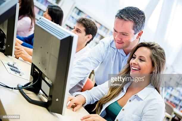 IT teacher helping a student