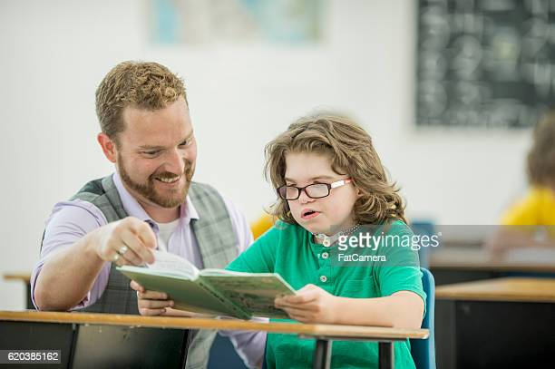 Teacher Helping a Student with a Learning Disability