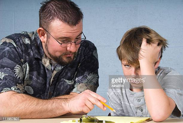 Teacher helping student with his homework