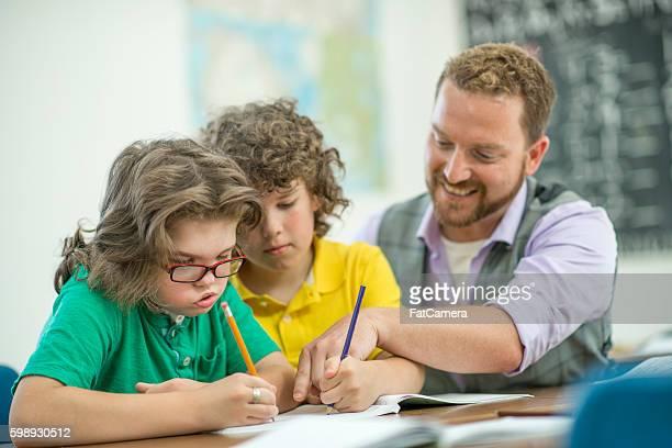 Teacher Helping Students After Class