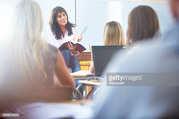 Teacher holding lesson in classroom