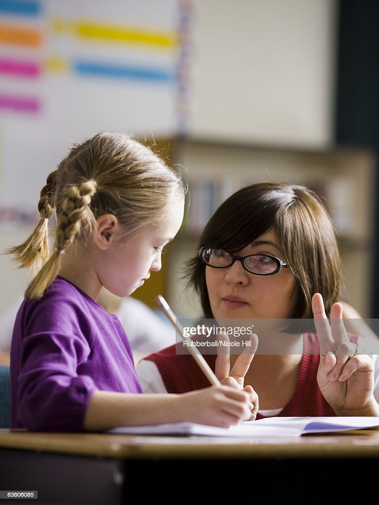 teacher in a classroom : Stock Photo