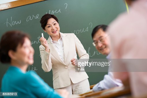 Teacher in Language Class : Stock Photo