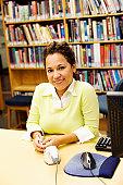 Teacher in library, smiling