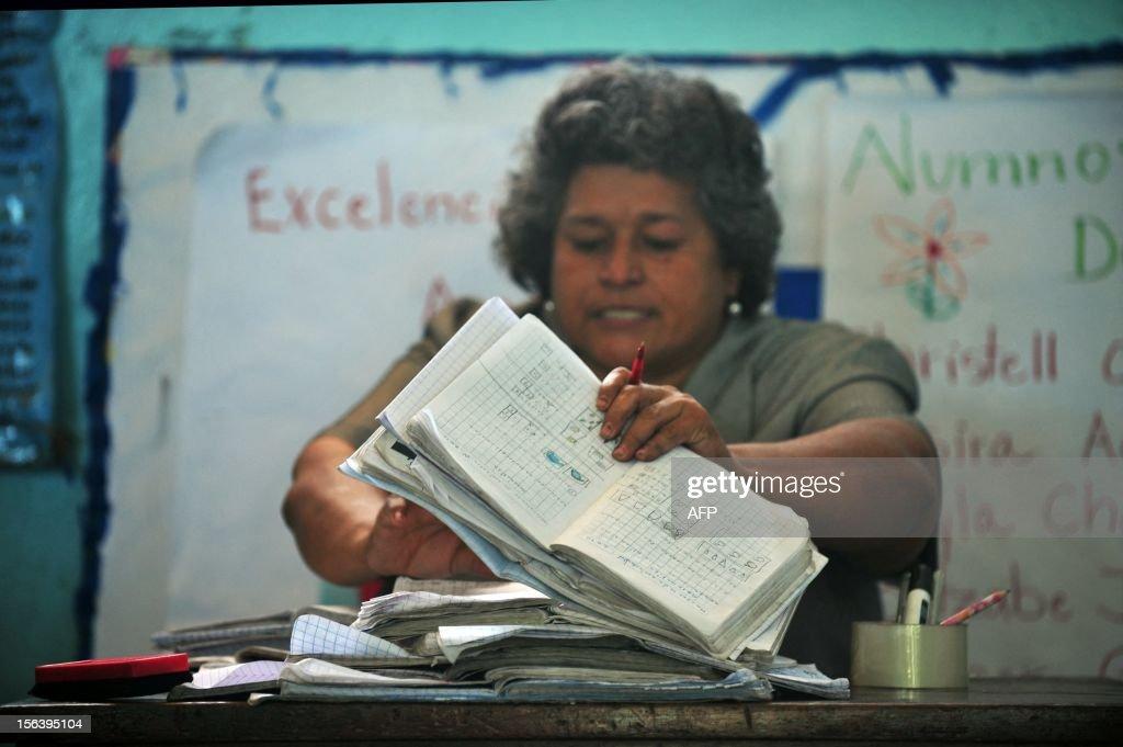 A teacher in the classroom at the 'Centro Alternativo Escuela Taller, El Proyecto' in Managua on November 14, 2012. AFP PHOTO/Hector RETAMAL