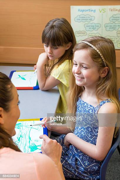 Teacher inspiring her young students