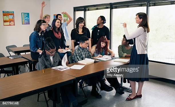 Teacher instructing a high school class.