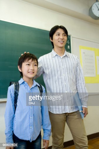 Teacher introducing a new student : Stock Photo