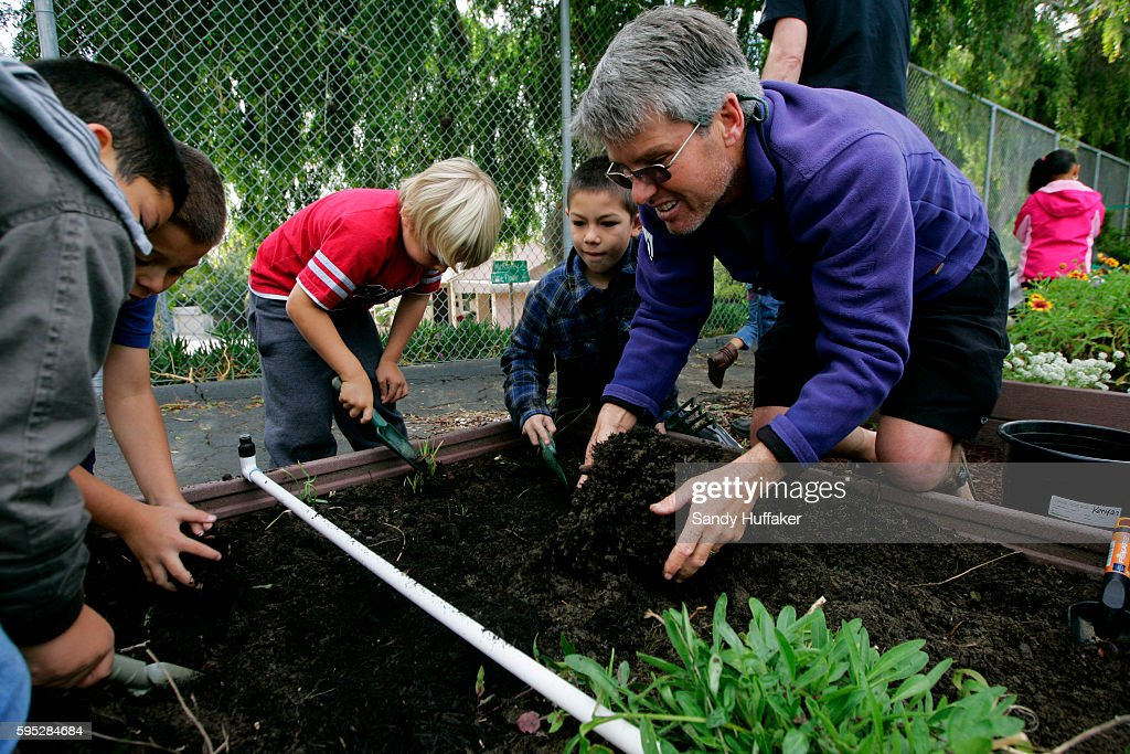Teacher Jon Rogers teaches students proper planting techniques in the Octopus Garden at McKinley Elementary School on Tuesday March 22 2011 in San...
