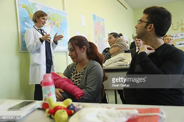 Teacher Laura Lueders dressed as a doctor leads a first orientation class for recentlyarrived immigrants including from countries such as Iraq...