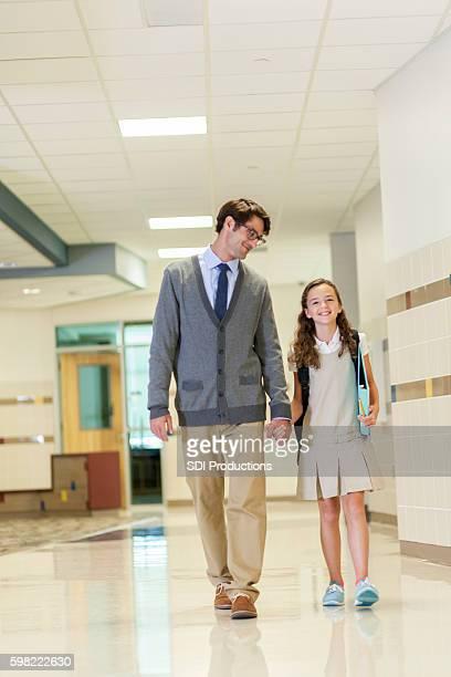 Teacher or principal walks student to class