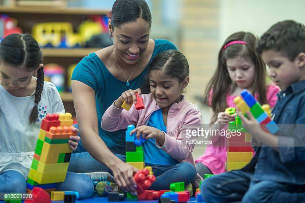 Teacher Playing with Her Students