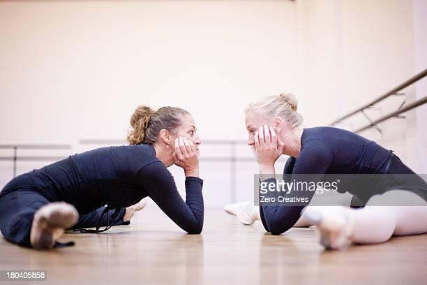 Teacher practicing floor pose with ballerina